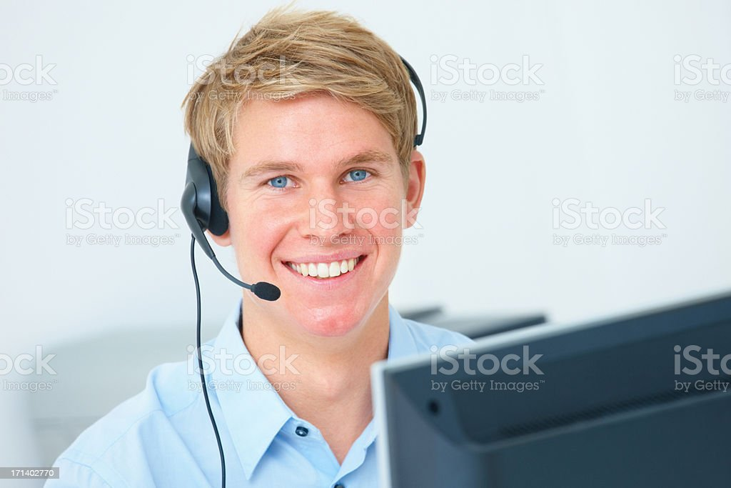 Closeup of a young business man wearing headset royalty-free stock photo