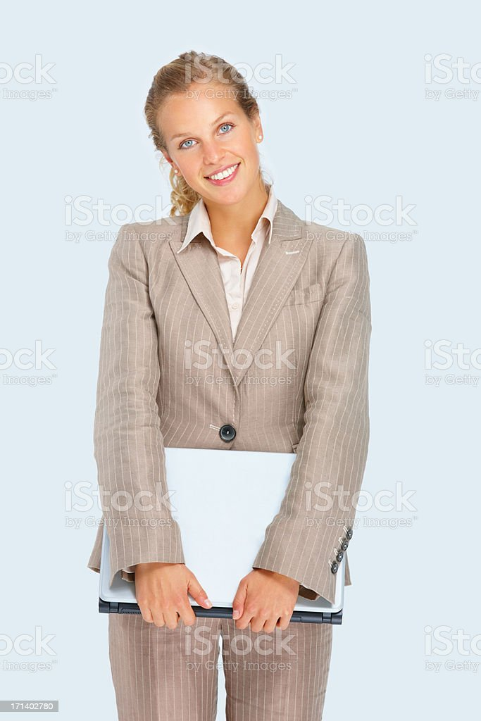 Closeup of a young business woman holding a laptop royalty-free stock photo