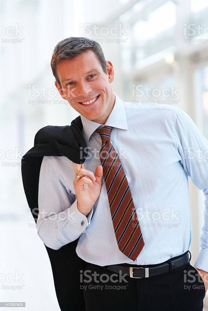 Close-up of a young businessman looking confident royalty-free stock photo