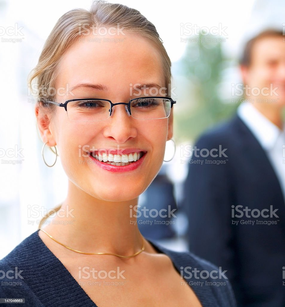 Close-up of a young businesswoman smiling royalty-free stock photo