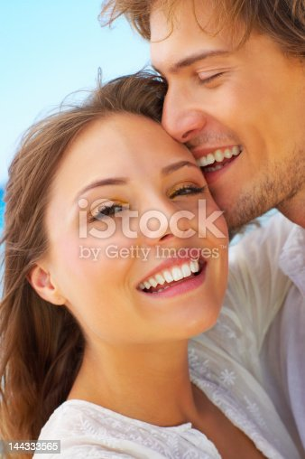 135359671 istock photo Close-up of a young couple loving on the beach 144333565