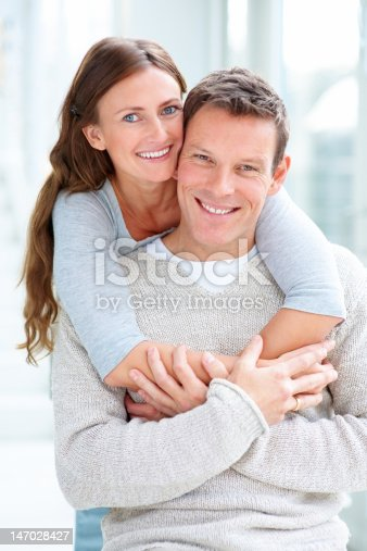 135359671 istock photo Close-up of a young couple smiling and embracing 147028427