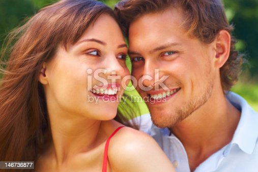 istock Close-up of a  young couple smiling 146736877