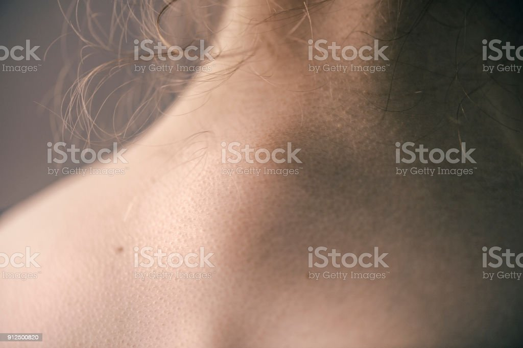 Close-Up of a Young Girl's Neck and Back stock photo