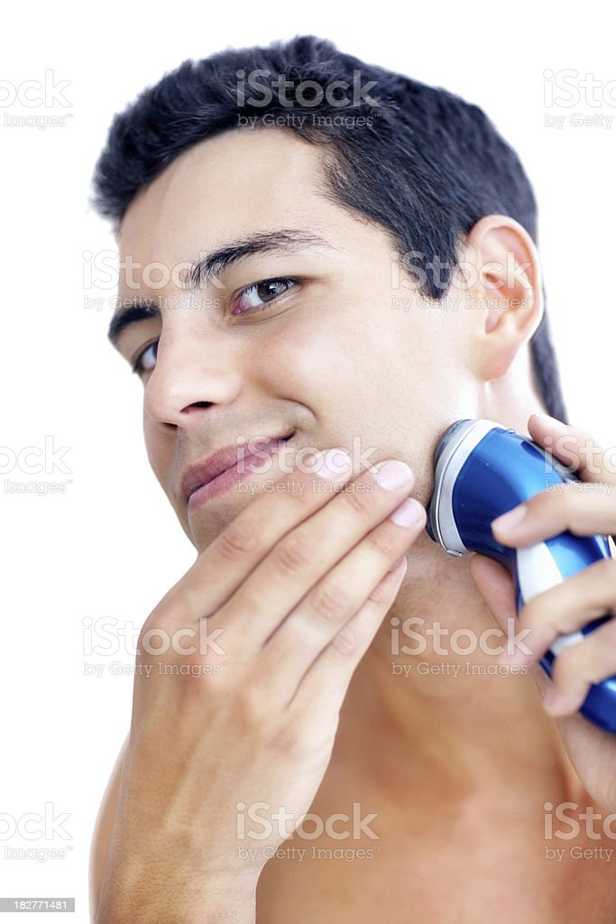 Closeup of a young male shaving with electric shaver royalty-free stock photo