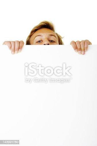 istock Close-up of a young man looking over white board 143991280