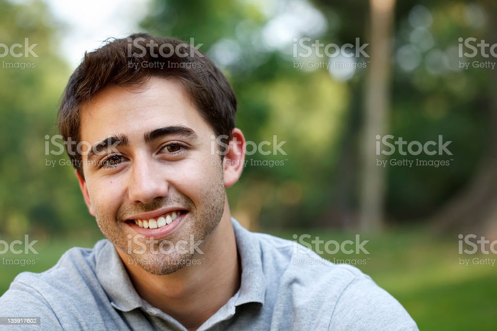 Close-up of a young man smiling stock photo