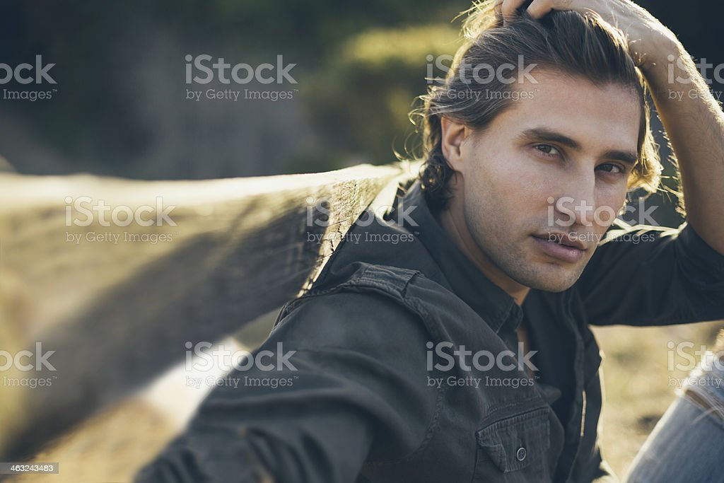 Close-up of a young man with his hand in hair stock photo