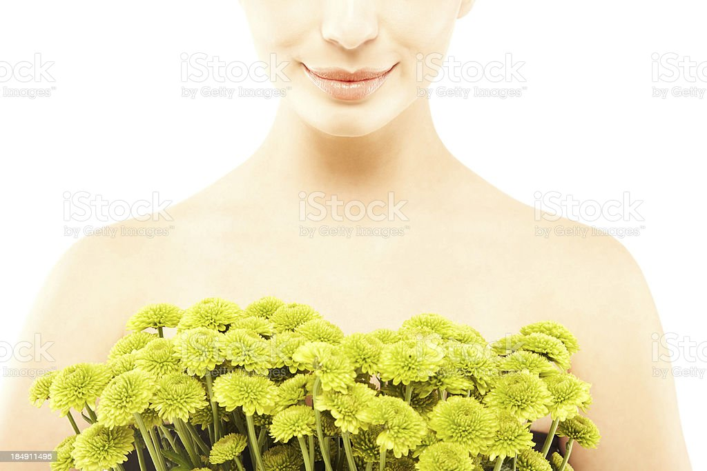 Close-up of a young smiling girl with flowers royalty-free stock photo