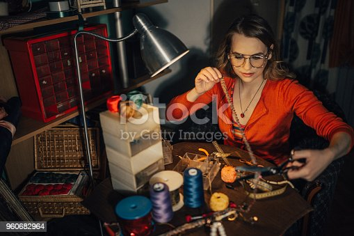 512345816istockphoto Close-up of a young woman cutting materials to make jewelry in the workshop 960682964
