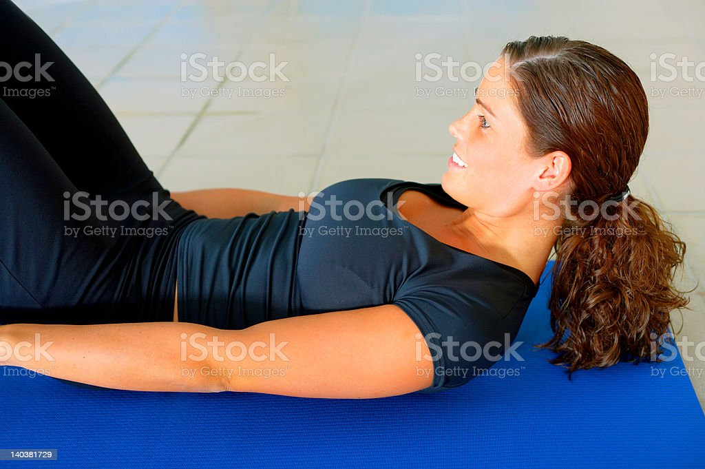 Close-up of a young woman exercising royalty-free stock photo