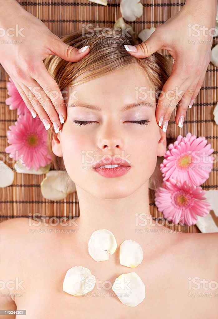 Close-up of a young woman getting head massage royalty-free stock photo