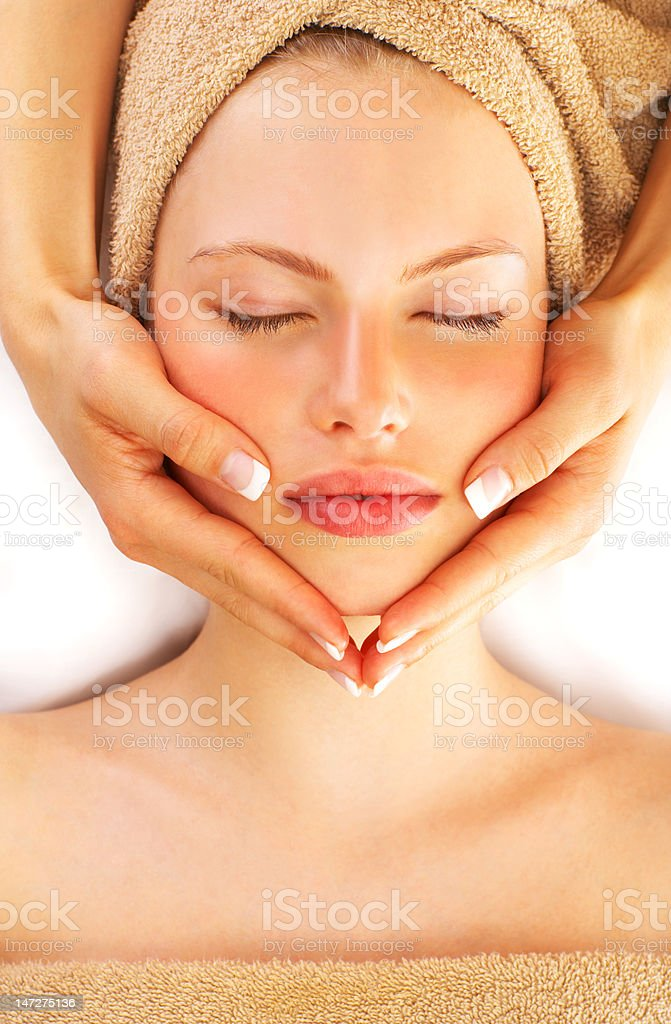 Close-up of a young woman getting spa treatment stock photo