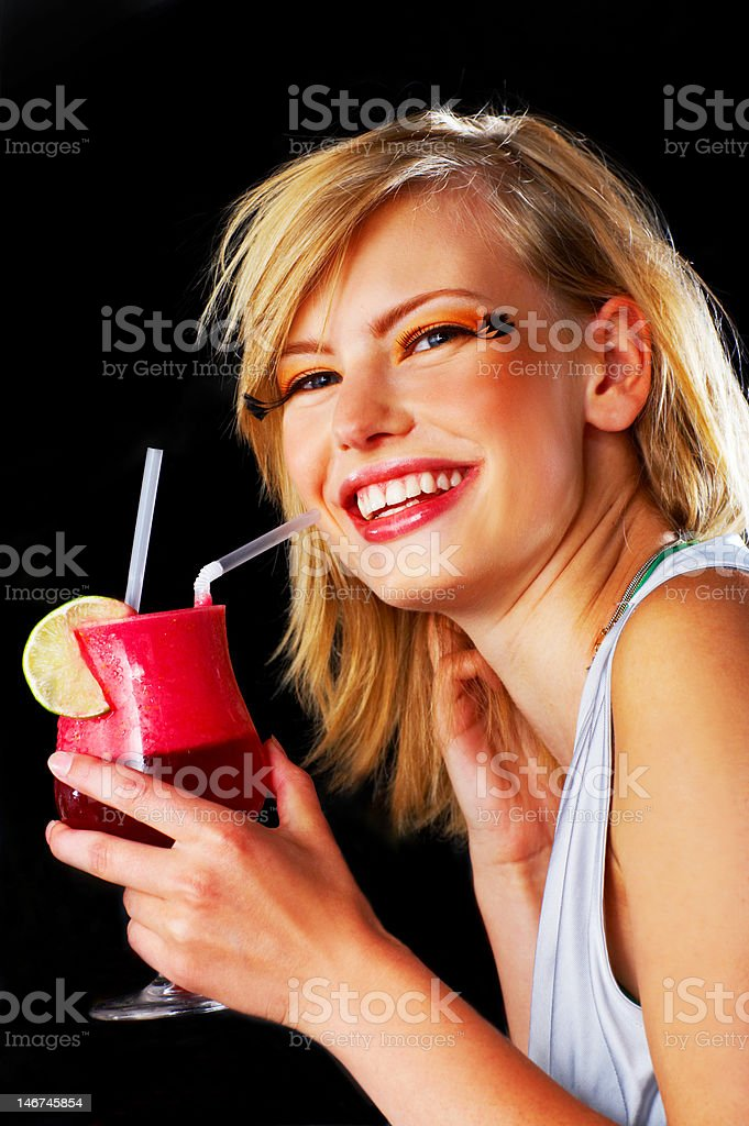 Close-up of a young woman holding cocktail and smiling royalty-free stock photo