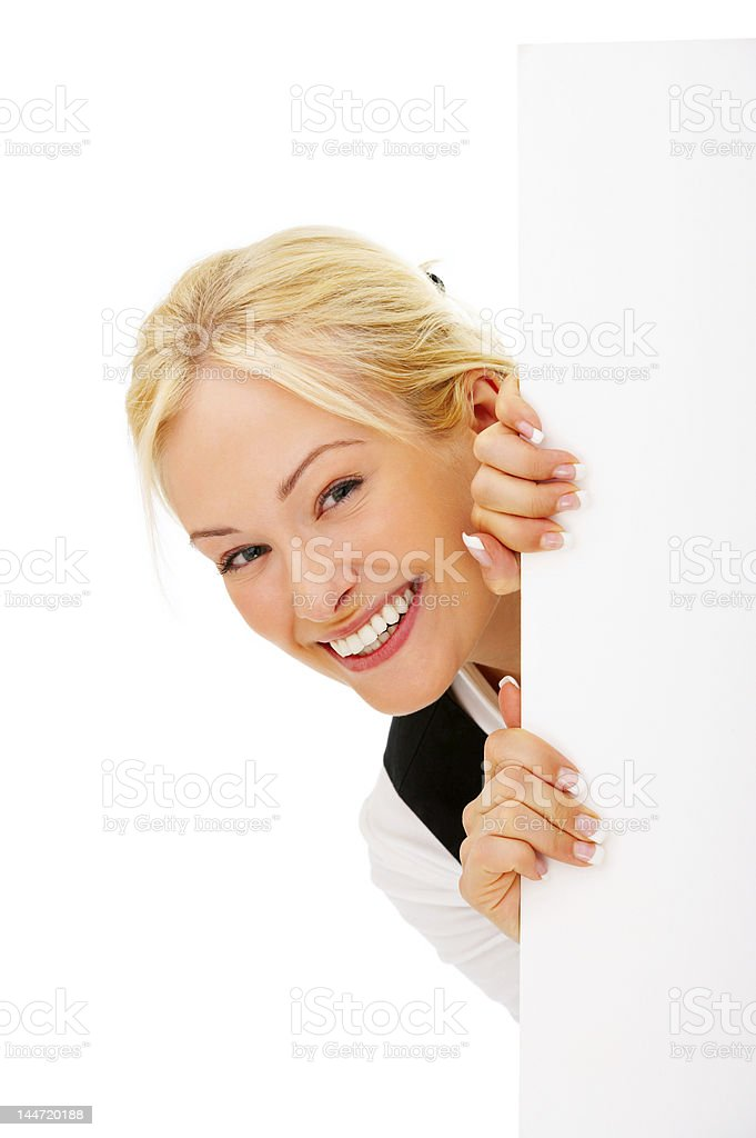 Close-up of a young woman holding signboard royalty-free stock photo
