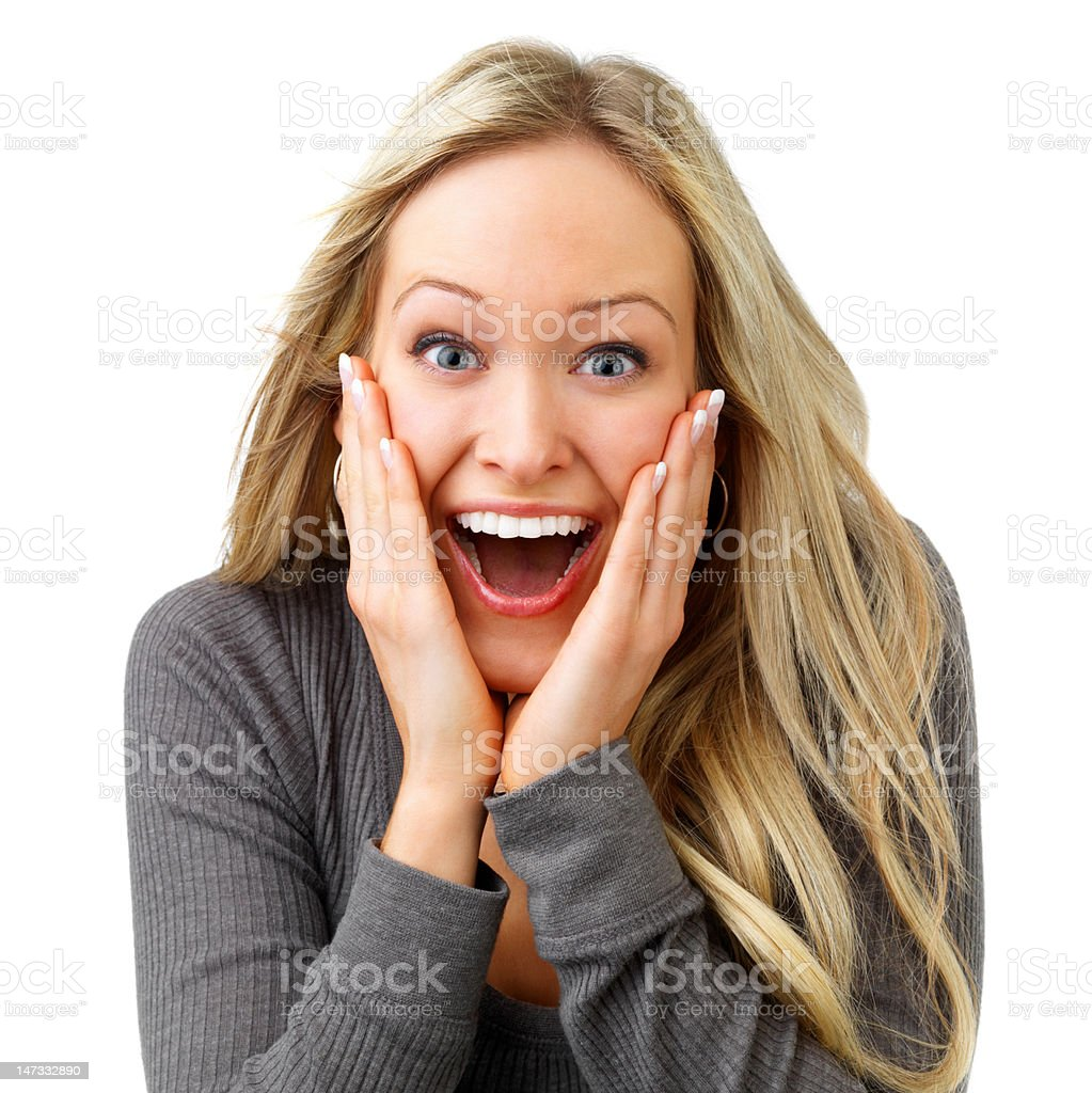 Close-up of a young woman looking excited against white background royalty-free stock photo