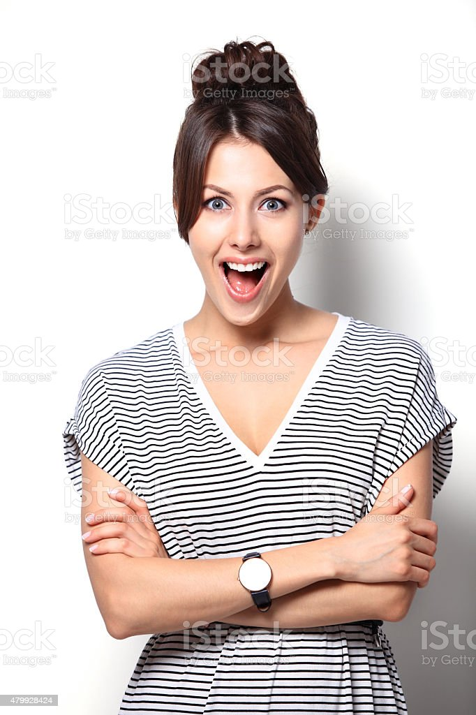 Close-up of a young woman looking surprised on white background stock photo