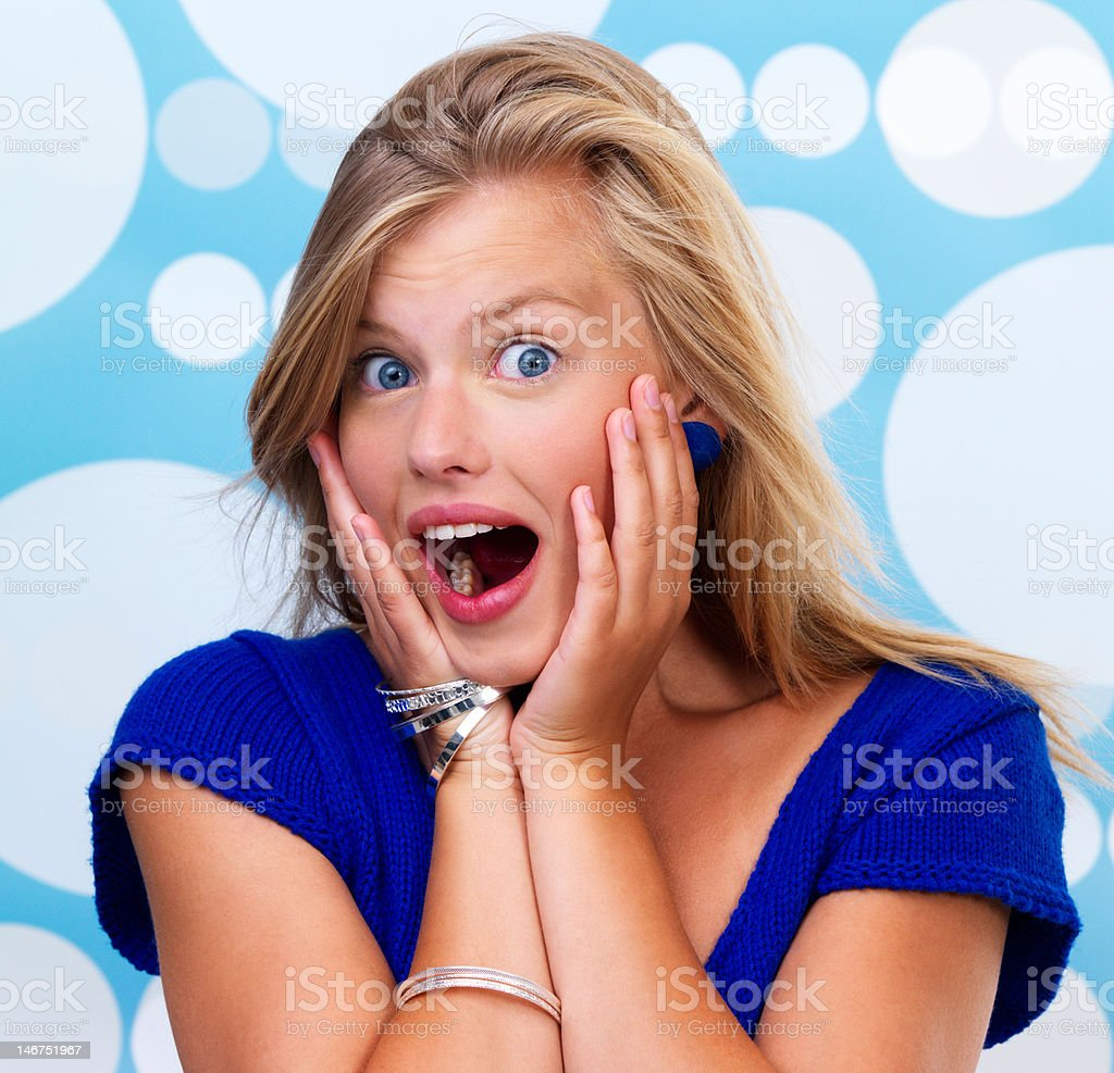 Close-up of a young woman looking surprised royalty-free stock photo