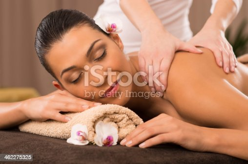 525211834istockphoto Close-Up Of A Young Woman Receiving Back Massage At Spa 462275325