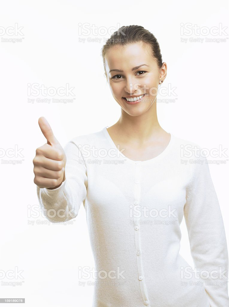 Close-up of a young woman showing thumbs up stock photo