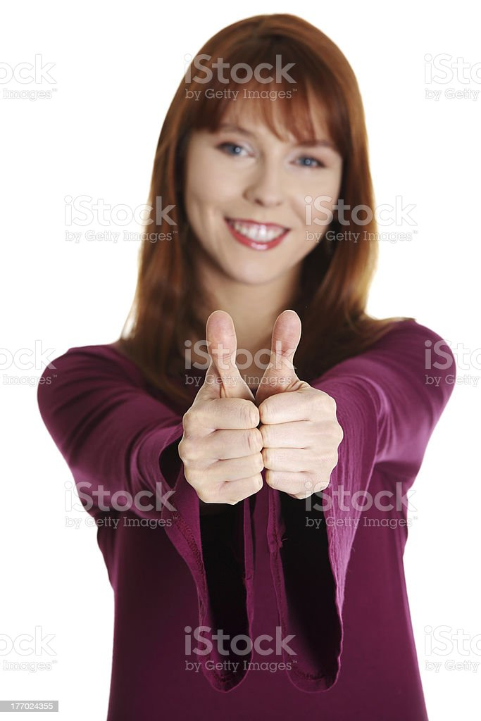 Close-up of a young woman showing thumbs up royalty-free stock photo