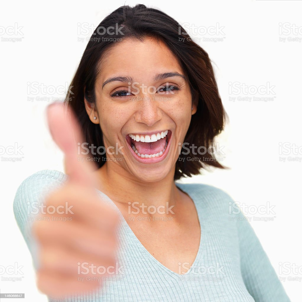 Close-up of a young woman showing thumbs up sign royalty-free stock photo