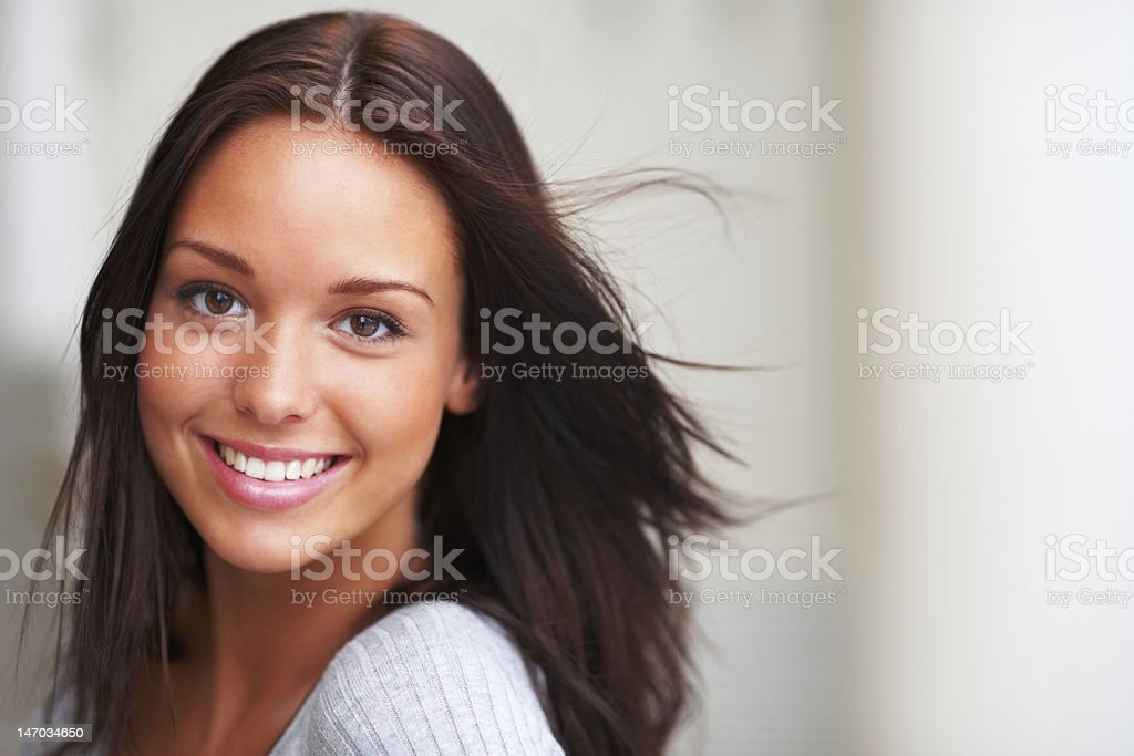 Close-up of a young woman smiling stock photo