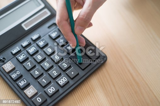 645670208istockphoto Closeup of Accountant Using Calculator 891872492