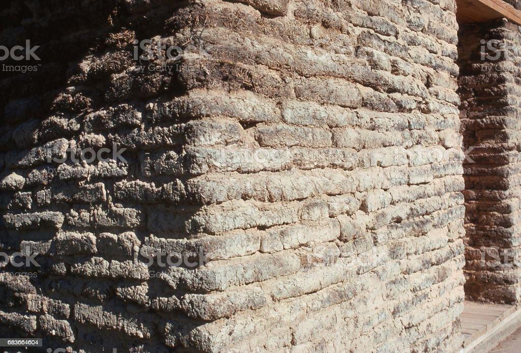 Closeup of adobe sod walls of a 'soddy' prairie house in public park of Scotts Bluff Nebraska stock photo