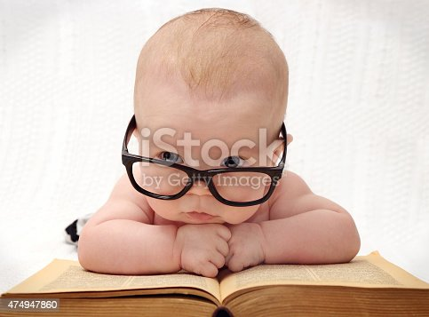 istock close-up of adorable baby in glasses 474947860