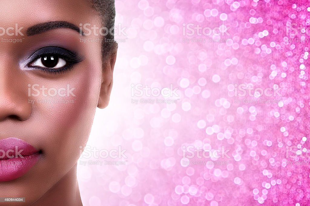Closeup of African American Woman Make Up with Copy Space stock photo