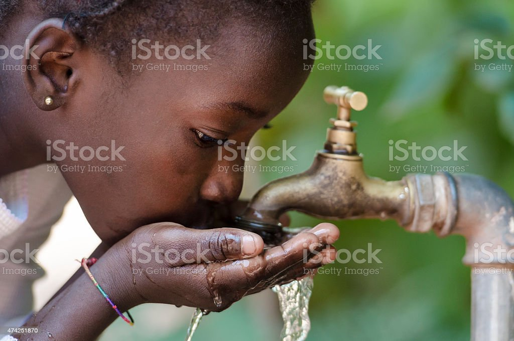 Close-Up of African Child Drinking Water (Drought Water Symbol) stock photo