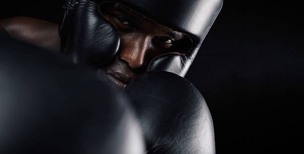 Close-up of african male boxer exercising stock photo
