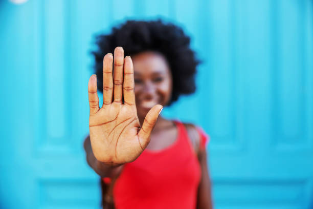 Closeup of african woman holding hand as a stop sign. stock photo