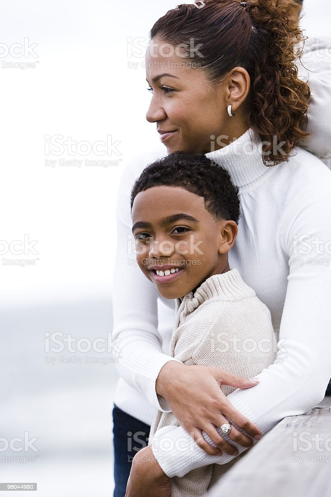 Close-up of African-American mother hugging son royalty-free stock photo