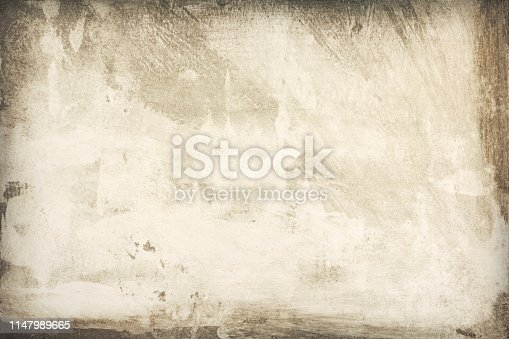 Background texture of aged paper with stained borders, close-up