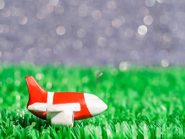 close-up of airplane model on artificial grass with bokeh background - aviation and environment summit stock photos and pictures