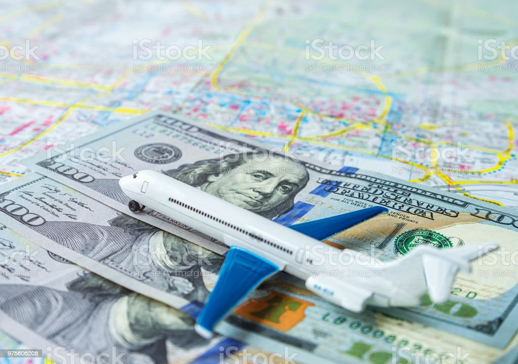 Closeup Of Airplane On Us Dollar Bills And Map Background - Us-map-close-up
