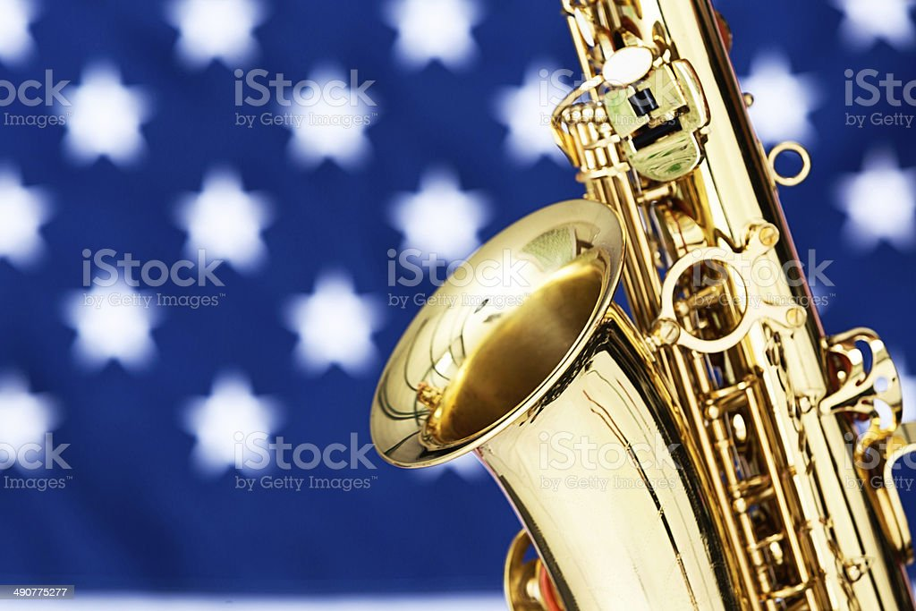 Close-up of alto sax against US flag stock photo