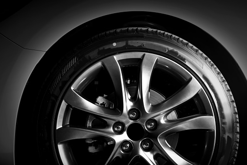 istock Close-up of aluminium rim of luxury car wheel 693988458