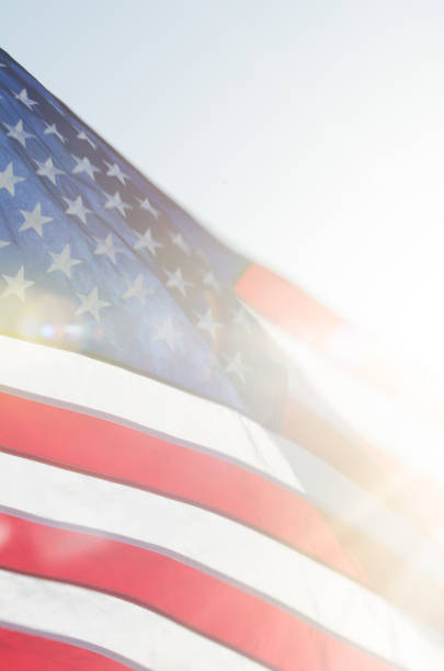 Close-Up of American Flag Backlit by the Sun stock photo