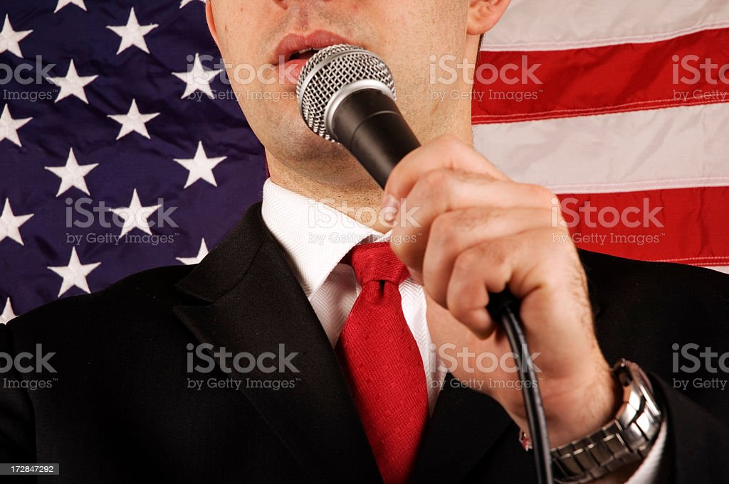 Close-up of American politician with American flag  royalty-free stock photo