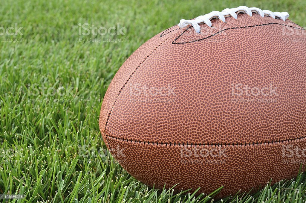 Close-up of an American Football on Grass Field royalty-free stock photo