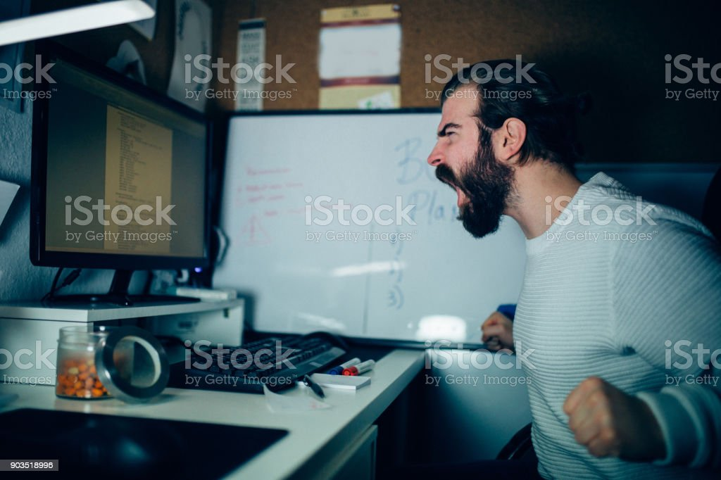 Close-up of an angry man working at the home office stock photo