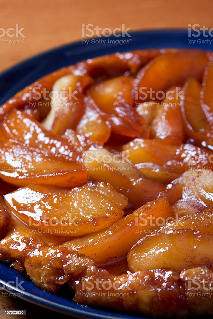 Close-up of an apple tarte tatin in a blue bowl royalty-free stock photo