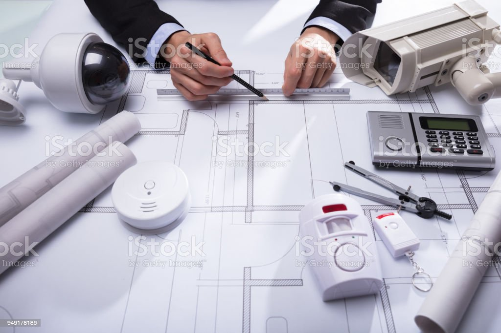 Close-up Of An Architect's Hand Drawing Blueprint stock photo