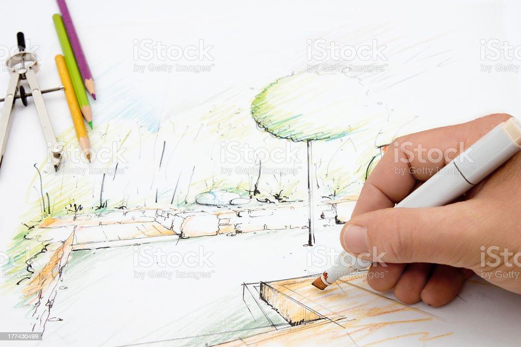 Close-up of an artist making a sketch of a garden stock photo