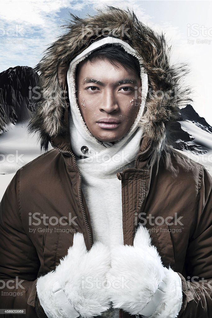 Close-up of an Asian man in winter gear stock photo