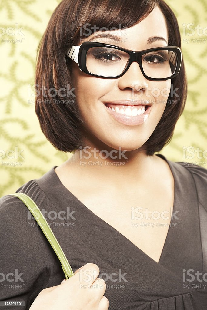 Close-up of an attractive young woman with glasses smiling royalty-free stock photo