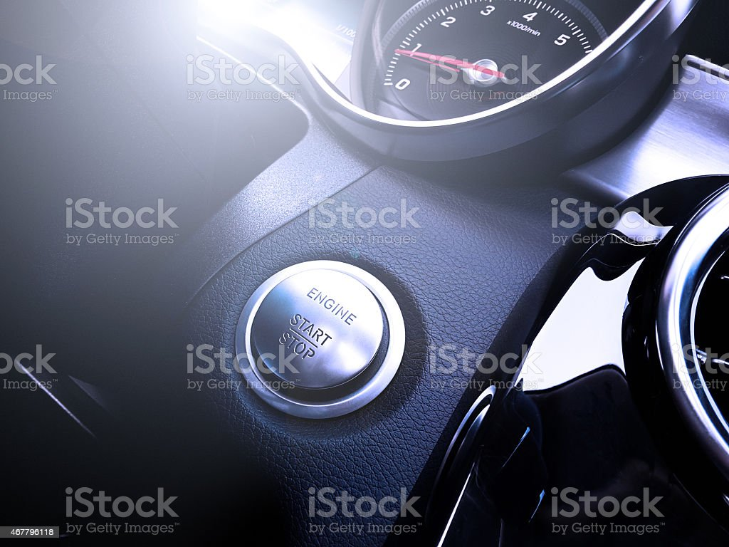 Close-up of an automatic start and stop car engine button stock photo